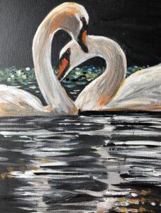 Swans smooching